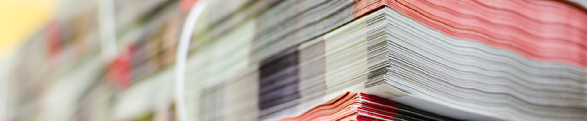 Pile of bundled magazines in offset print plant delivery department, selective focus background